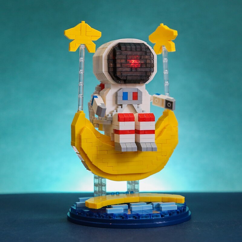 Wise Hawk 2702 Spaceman Sitting on Moon Star Water with LED Light Display Covered Wood Base